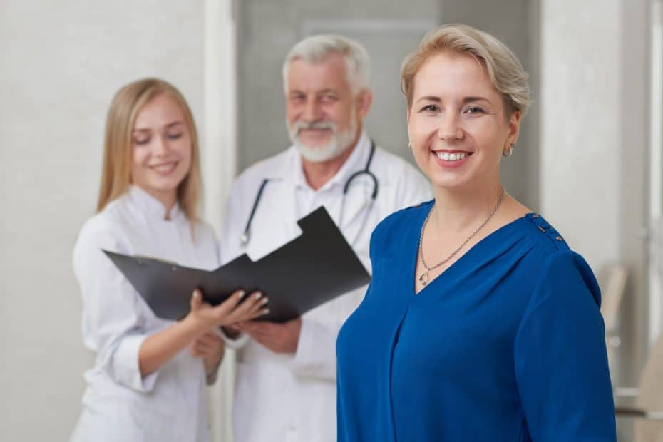 Happy patient and doctors posing, smiling